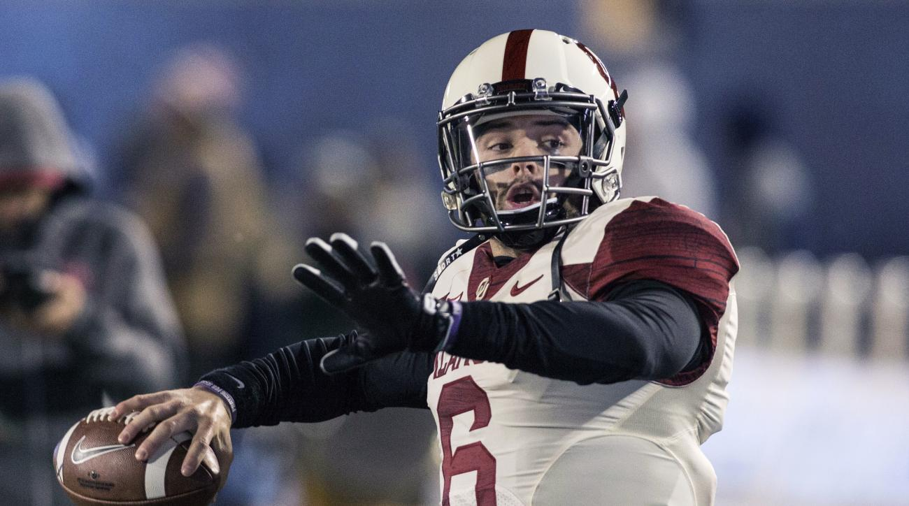 FILE - In this Saturday, Nov. 19, 2016, file photo, Oklahoma quarterback Baker Mayfield starts to throw a pass during the first half of an NCAA college football game against West Virginia, in Morgantown, W.Va. No. 11 Oklahoma State plays No. 7 Oklahoma in
