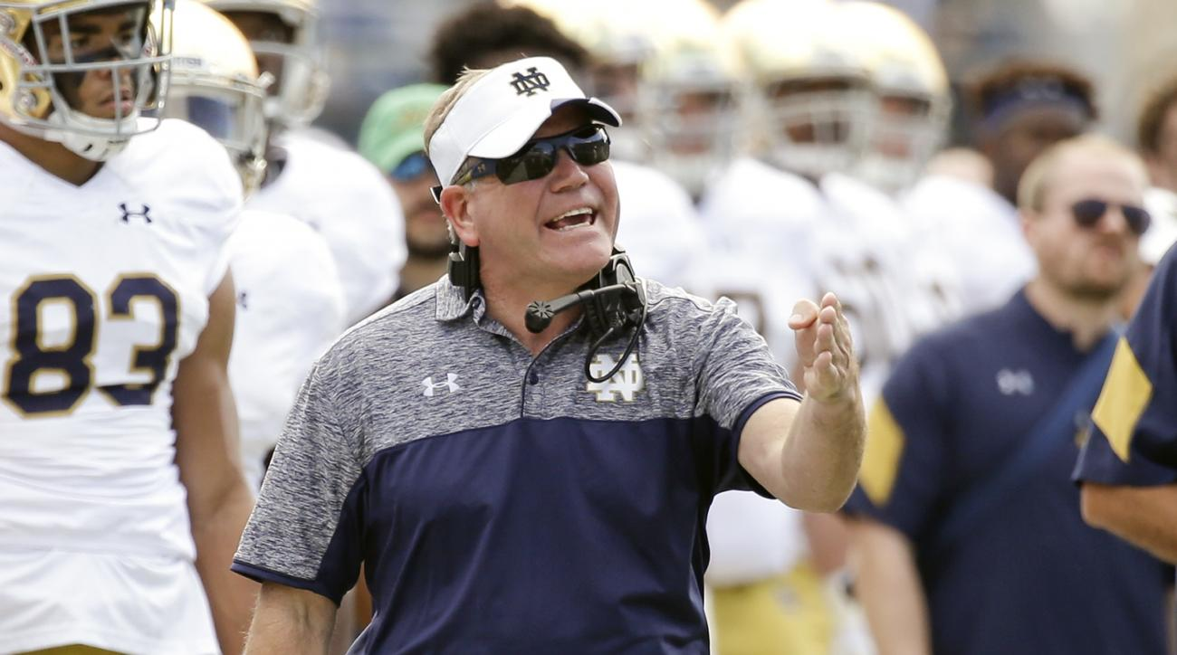 FILE - In this Nov. 5, 2016, file photo, Notre Dame head coach Brian Kelly shouts to his players during the second half of an NCAA college football game against Navy, in Jacksonville, Fla. Athletic director Jack Swarbrick says its business as usual at Not