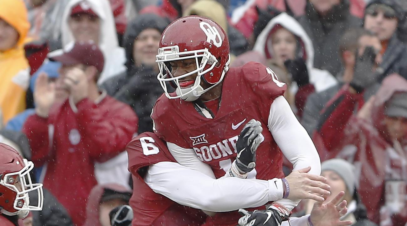 Oklahoma wide receiver Dede Westbrook (11) and quarterback Baker Mayfield (6) celebrate after Westbrook's touchdown against Oklahoma State during the first half of an NCAA college football game, Saturday, Dec. 3, 2016, in Norman, Okla. (AP Photo/Alonzo Ad
