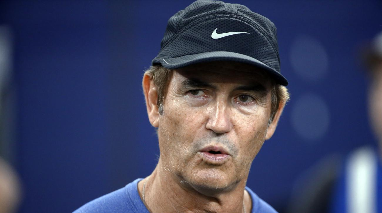 FILE - In this Sept. 25, 2016, file photo, former Baylor football coach Art Briles watches the Dallas Cowboys and the Chicago Bears warm up for an NFL football game in Arlington, Texas. Houston athletic director Hunter Yurachek says former Baylor coach Ar