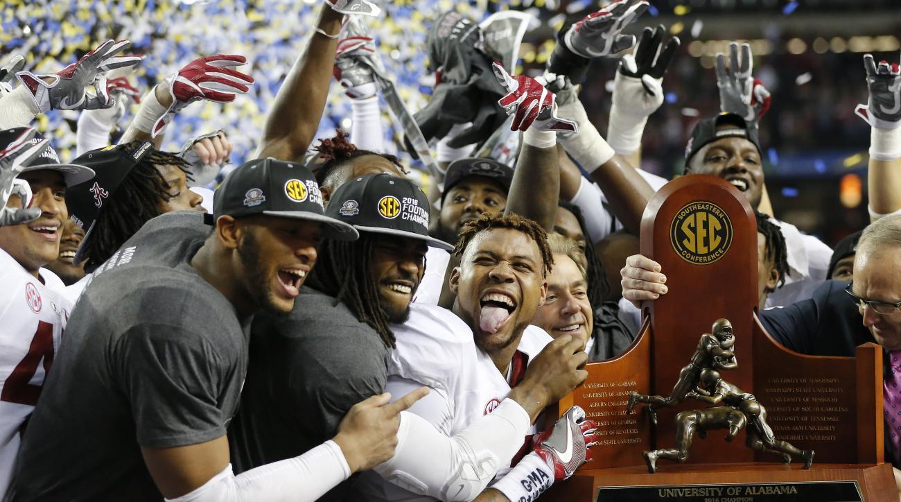 Alabama team members celebrate after the Southeastern Conference championship NCAA college football game against Florida, Saturday, Dec. 3, 2016, in Atlanta. Alabama won 54-16. (AP Photo/John Bazemore)