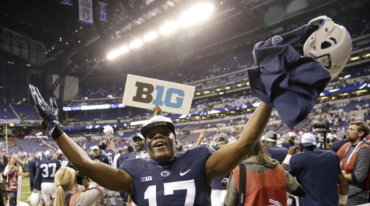 Penn State's Garrett Taylor celebrates his team's victory over Wisconsin in the Big Ten championship NCAA college football game Saturday, Dec. 3, 2016, in Indianapolis. Penn State won 38-31. (AP Photo/AJ Mast)