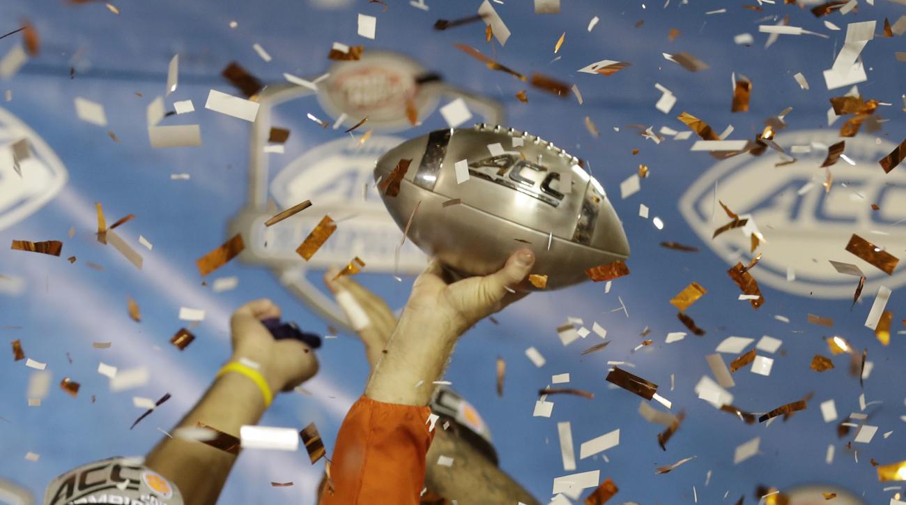 Clemson head coach Dabo Swinney raises the Atlantic Coast Conference championship NCAA college football trophy, Sunday, Dec. 4, 2016, in Orlando, Fla. Clemson defeated Virginia Tech 42-35. (AP Photo/Chris O' Meara)