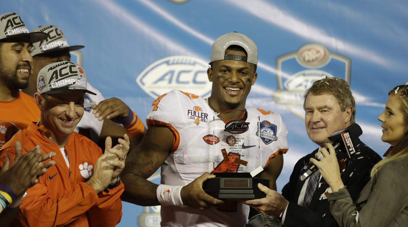 Clemson quarterback Deshaun Watson (4) receives the ACC game MVP player award at the end of the Atlantic Coast Conference championship NCAA college football game, Sunday, Dec. 4, 2016, in Orlando, Fla. Clemson defeated Virginia Tech 42-35. (AP Photo/Chris