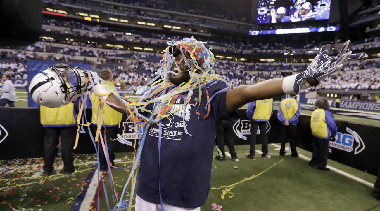 Penn State's Ayron Monroe celebrates Penn State defeated Wisconsin in the Big Ten championship NCAA college football game Sunday, Dec. 4, 2016, in Indianapolis. Penn State won 38-31. (AP Photo/Michael Conroy)