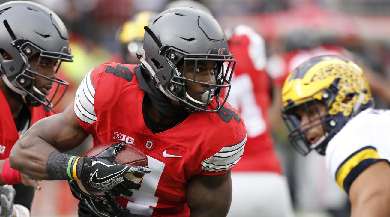 FILE - In this Saturday, Nov. 26, 2016, file photo, Ohio State running back Curtis Samuel runs the ball against Michigan during the first half of an NCAA college football game in Columbus, Ohio. Ohio State didn't win the Big Ten, but the Buckeyes will pla