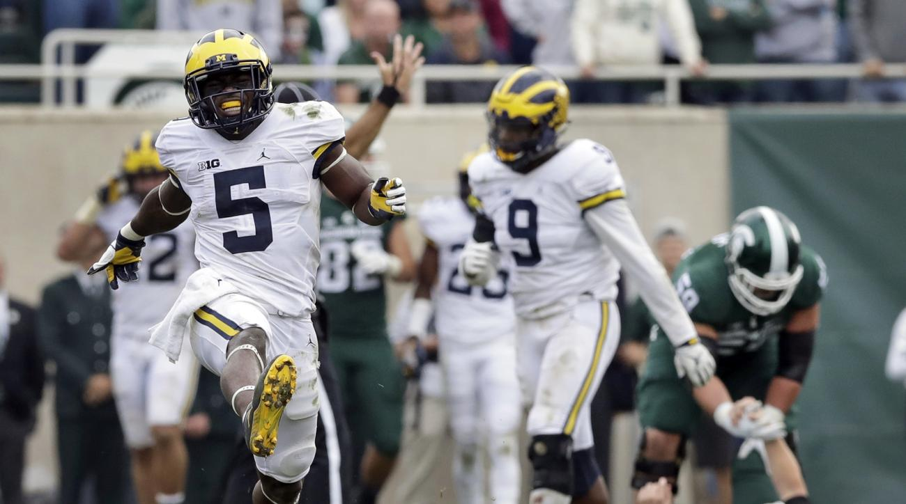 FILE - In this Oct. 29, 2016, file photo, Michigan linebacker Jabrill Peppers (5) celebrates after sacking Michigan State quarterback Brian Lewerke (14) during the second half of a college football game, in East Lansing, Mich. Peppers was voted the defens