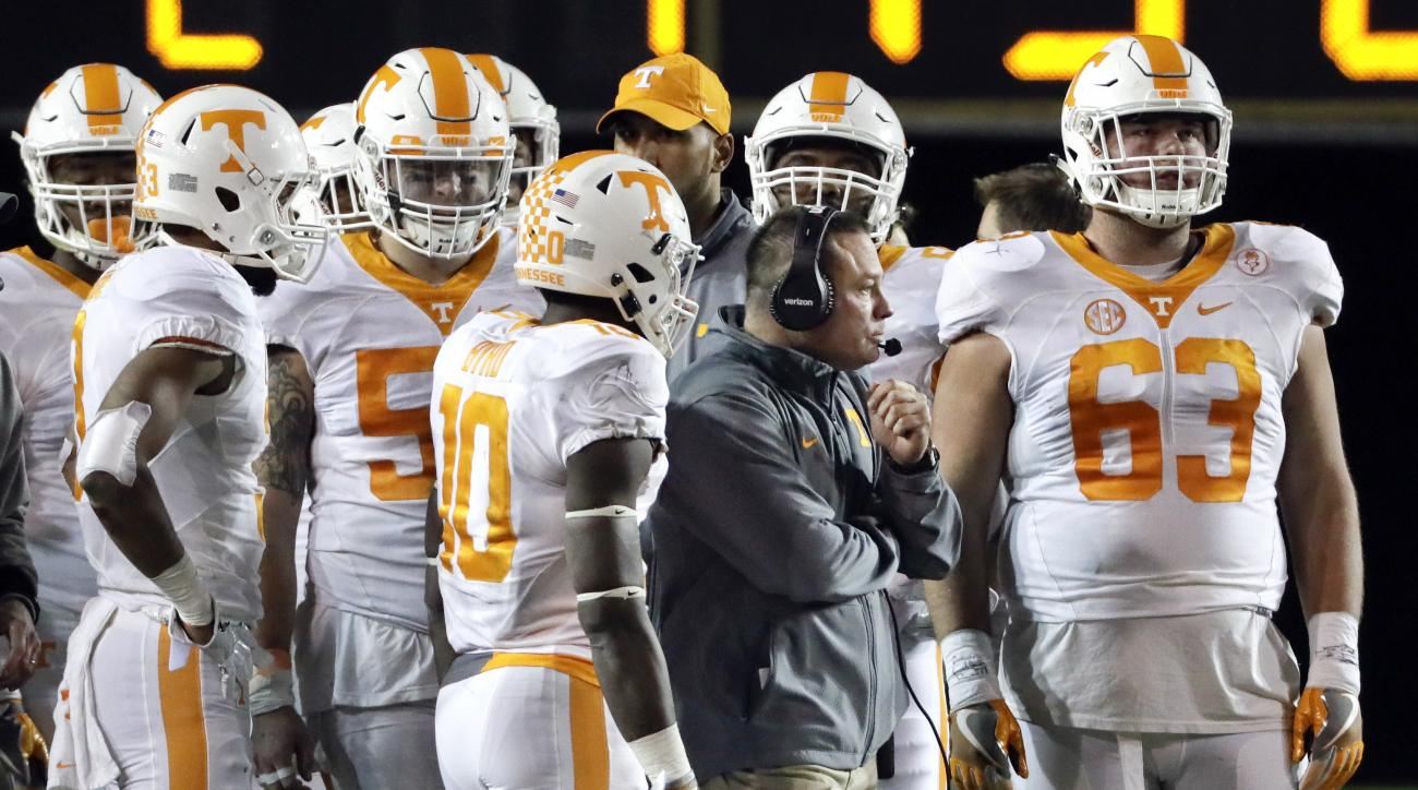FILE -- In this Nov. 26, 2016, file photo, Tennessee head coach Butch Jones talks with his players during a 45-34 loss to Vanderbilt in an NCAA college football game in Nashville, Tenn. Tennessee will be making a return trip to Nashville Dec. 30 for a Mus