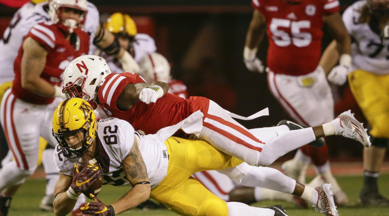 FILE - In this Nov. 12, 2016, file photo, Minnesota wide receiver Drew Wolitarsky (82) makes a catch while being defended by Nebraska safety Kieron Williams, top, during the second half of an NCAA college football game in Lincoln, Neb.  the Gophers have a