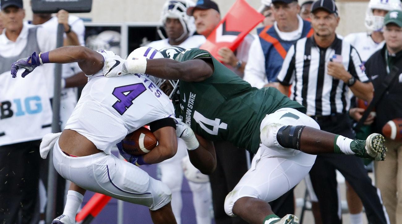 FILE - In this Sept. 2, 2016, file photo, Michigan State's Malik McDowell, right, tackles Furman's Richard Hayes III for a 6-yard loss during the first quarter of an NCAA college football game, in East Lansing, Mich. McDowell is entering the NFL draft, sk