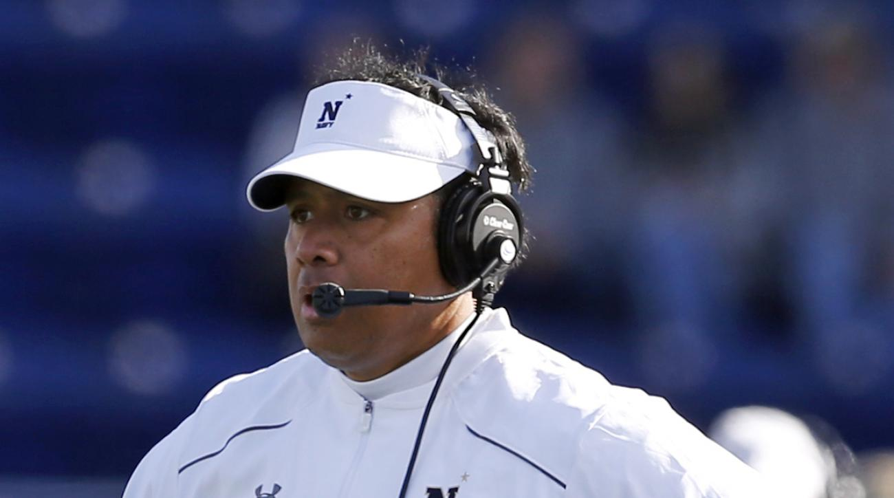FILE - In this Oct. 31, 2015, file photo, Navy head coach Ken Niumatalolo stands on the field in the second half of an NCAA college football game against South Florida, in Annapolis, Md. Navys triple option will have to rely on spare parts Saturday agains