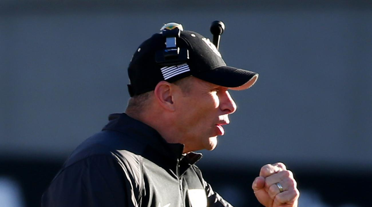 FILE - In this Nov. 7, 2015, file photo, Army head coach Jeff Monken cheers on his team against Air Force during the second half of an NCAA college football game at Air Force Academy, Colo. Navys triple option will have to rely on spare parts Saturday aga