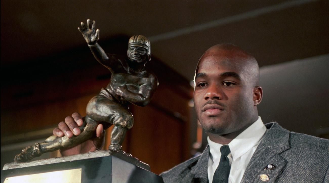 FILE - In this Dec. 10, 1994, file photo, Colorado's Rashaan Salaam poses with his 1994 Heisman Trophy at the Downtown Athletic Club in New York. Authorities say Rashaan Salaam has been found dead in a park in Boulder, Colo. The Boulder County coroners of