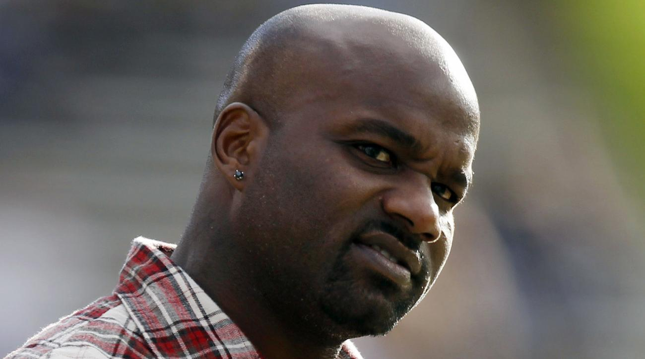 FILE - In this Nov. 7, 2012, file photo, former Colorado running back and Heisman Trophy winner Rashaan Salaam watches from the sidelines during the third quarter of an NCAA college football game between Colorado and Washinnton, in Boulder, Colo. Authorit