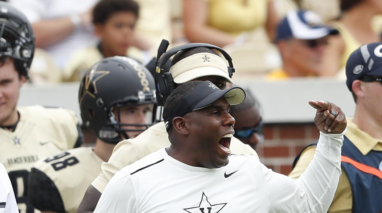 FILE - In this Sept. 17, 2016, file photo, Vanderbilt head coach Derek Mason yells to his players in the first half of an NCAA college football game against Georgia, in Atlanta. The upcoming bowl games give the Southeastern Conference a chance to earn red