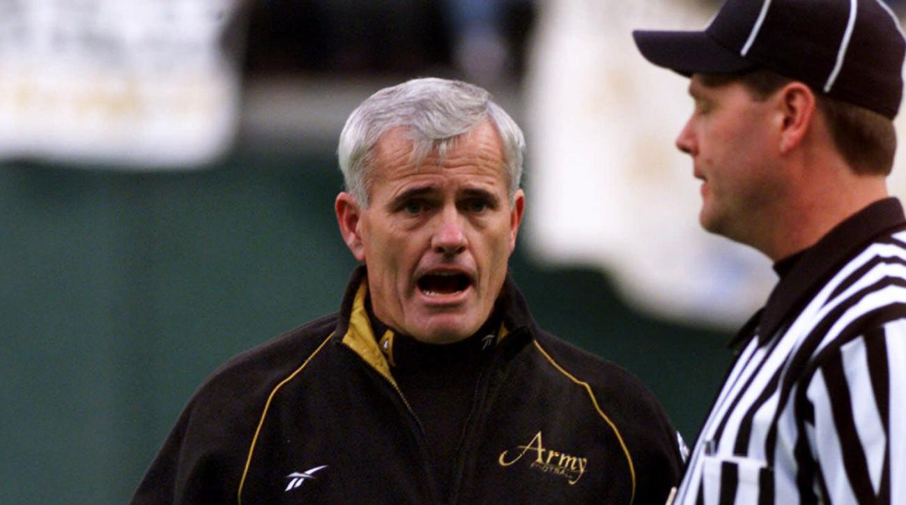 FILE - In this Dec. 5, 1999,  file photo, then-Army football coach Bob Sutton approaches a referee during the Army-Navy game in Philadelphia. Despite the recent lopsidedness of the fierce Army-Navy rivalry _ the Middies have won 14 straight _ Sutton says