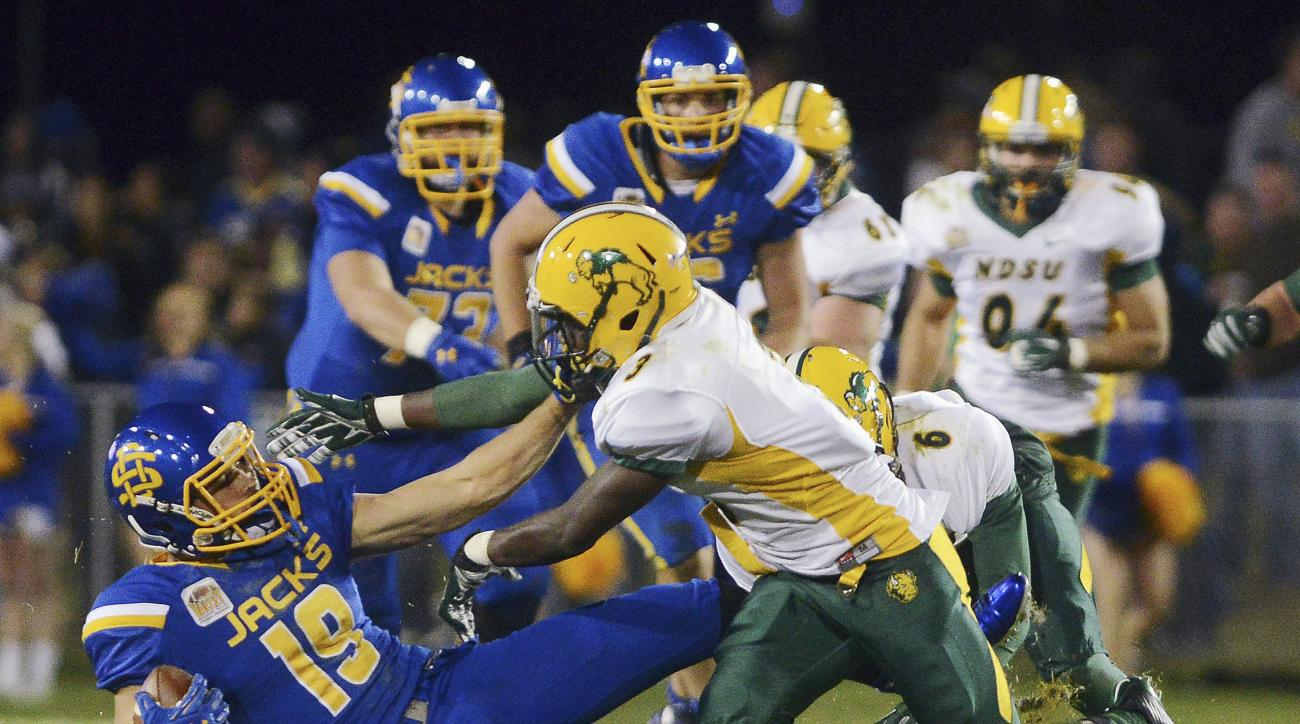 FILE - In this Oct. 3, 2015, file photo, North Dakota State's Tre Dempsey takes down South Dakota State's Jake Wieneke (19) during an NCAA college football game in Brookings, S.D. NDSU at 11-1 hostsan Football Championship Subdivision quarterfinal game Sa