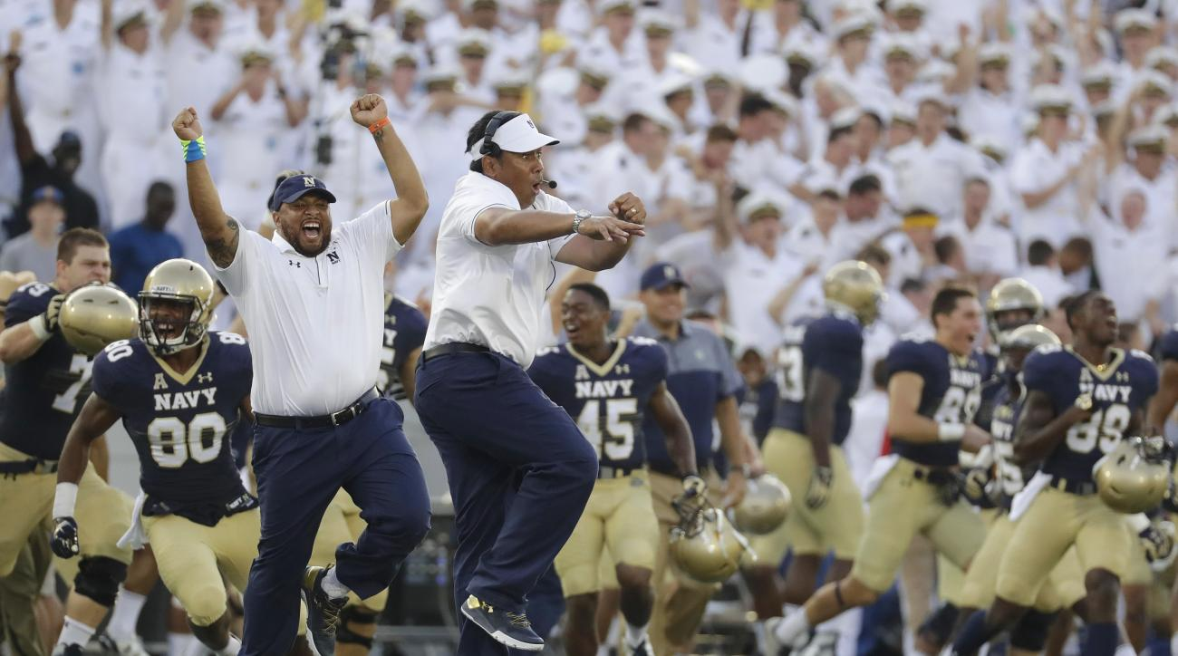 FILE - In this Sept. 10, 2016, file photo, Navy head coach Ken Niumatalolo, center, celebrates after an NCAA college football game against Connecticut in Annapolis, Md. It doesnt matter that neither Army nor Navy are in the Top 25, or that the Midshipmen