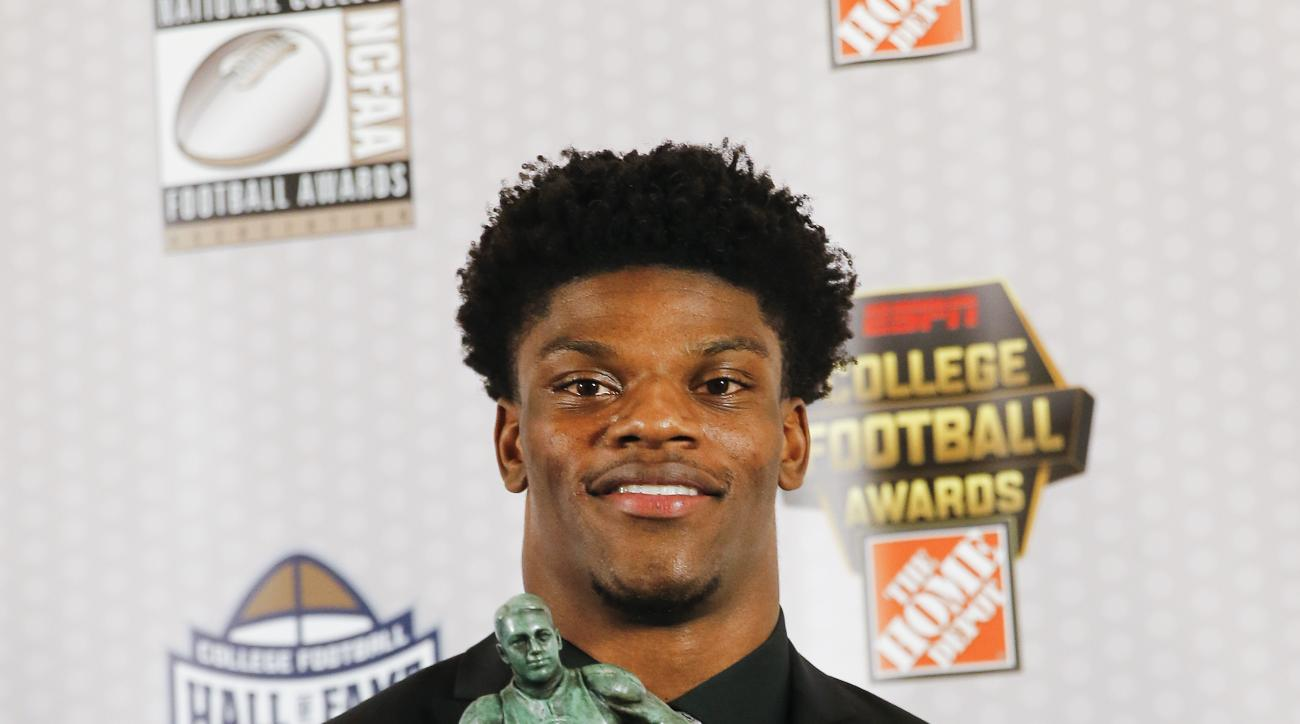 Louisville quarterback Lamar Jackson poses with the Maxwell Award after being named the College Football Player of the Year Thursday, Dec. 8, 2016, in Atlanta. (AP Photo/John Bazemore)