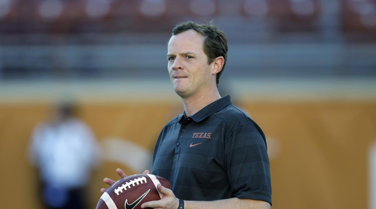 Texas offensive coordinator Major Applewhite directs warmups prior to an NCAA college football game against Kansas State, Saturday,  Sept. 21, 2013, in Austin, Texas. (AP Photo/Eric Gay)