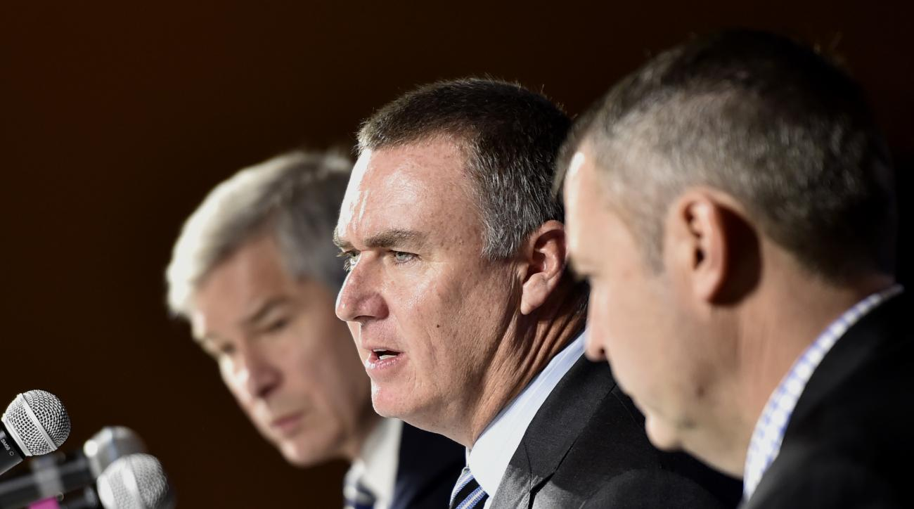 Shawn Elliott, center, speaks at an NCAA college football press conference where he was introduced as the head football coach for Georgia State, Friday, Dec. 9, 2016, in Atlanta. He was joined by Georgia State president, Mark Becker, left, and director of