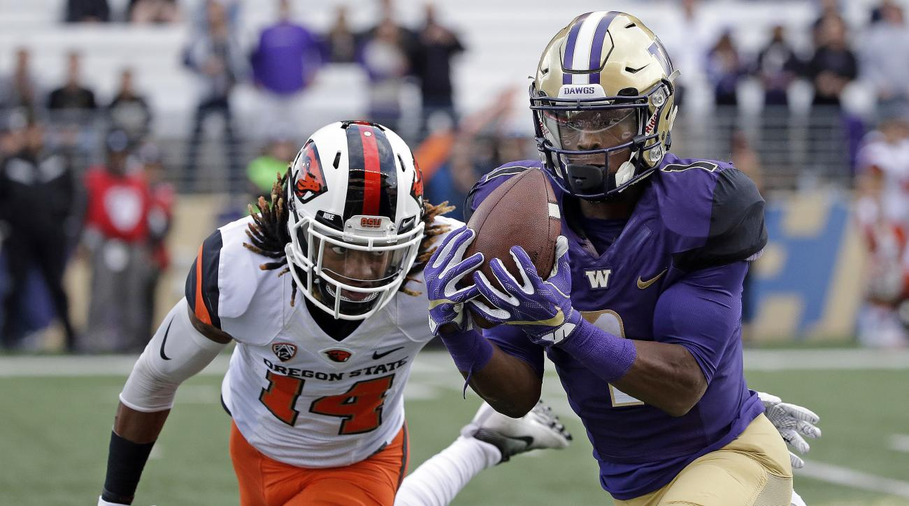 FILE - In this Oct. 22, 2016, file photo,Washington's John Ross, right, makes a long pass reception in front of Oregon State's Treston Decoud in the first half of an NCAA college football game in Seattle. Ross is the player of the year on the Associated P