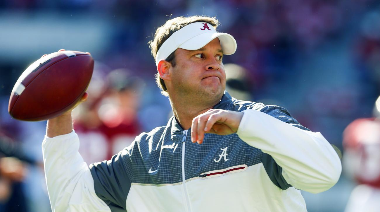 FILE - In this Saturday, Nov. 26, 2016 file photo, Alabama offensive coordinator Lane Kiffin throws a pass during warmups before the Iron Bowl NCAA football game against Auburn  in Tuscaloosa, Ala. Alabama offensive coordinator Lane Kiffin is being pursue