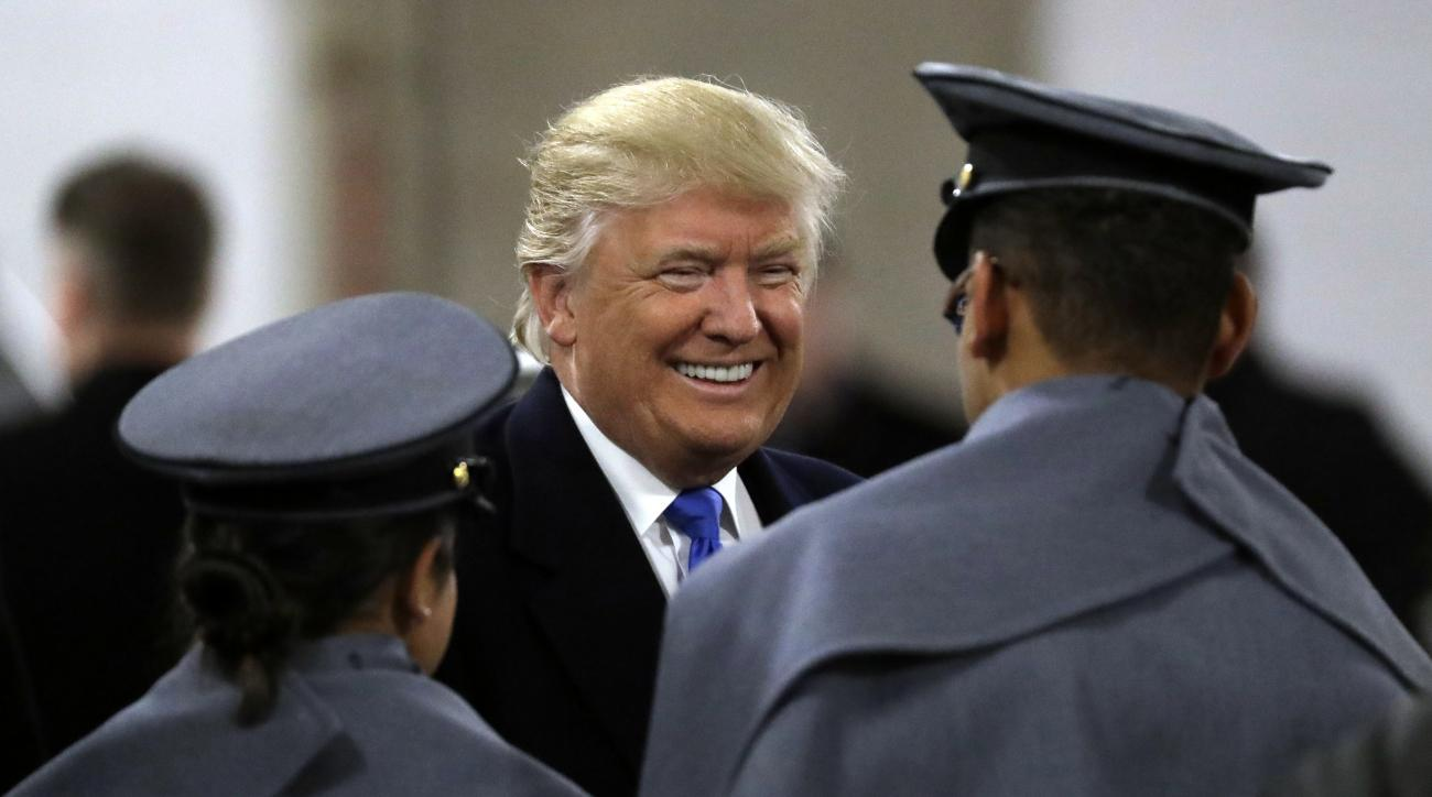 President-elect Donald Trump, center, greets Army Cadets before the Army-Navy NCAA college football game in Baltimore, Saturday, Dec. 10, 2016. (AP Photo/Patrick Semansky)
