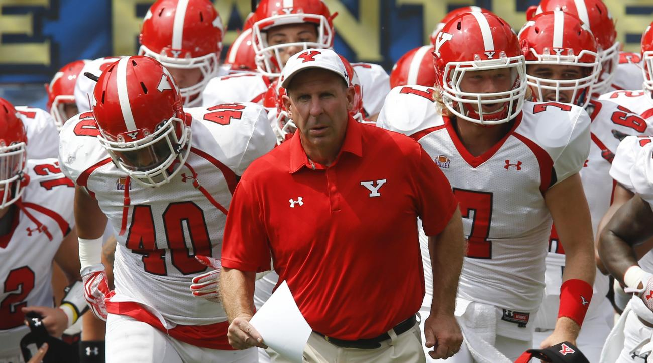 Youngstown State head coach Bo Pelini leads his team on to the field before an NCAA football game between the Pittsburgh and the Youngstown State Penguins, Saturday, Sept. 5, 2015 in Pittsburgh. (AP Photo/Keith Srakocic)