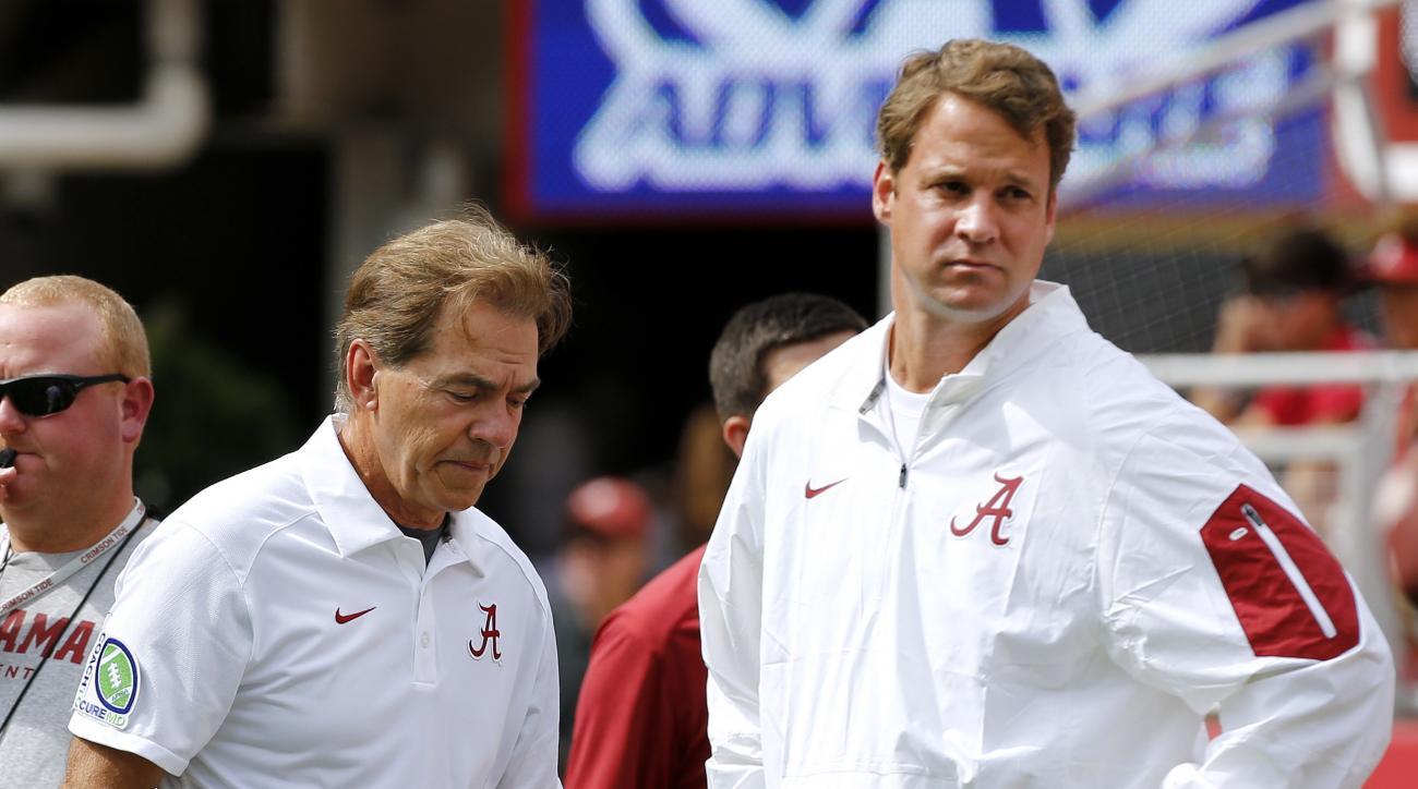 FILE - In this Sept. 26, 2015, file photo, Alabama head coach Nick Saban, left, and offensive coordinator Lane Kiffin stand next to each other before an NCAA college football game against Louisiana Monroe in Tuscaloosa, Ala. A person with direct knowledge