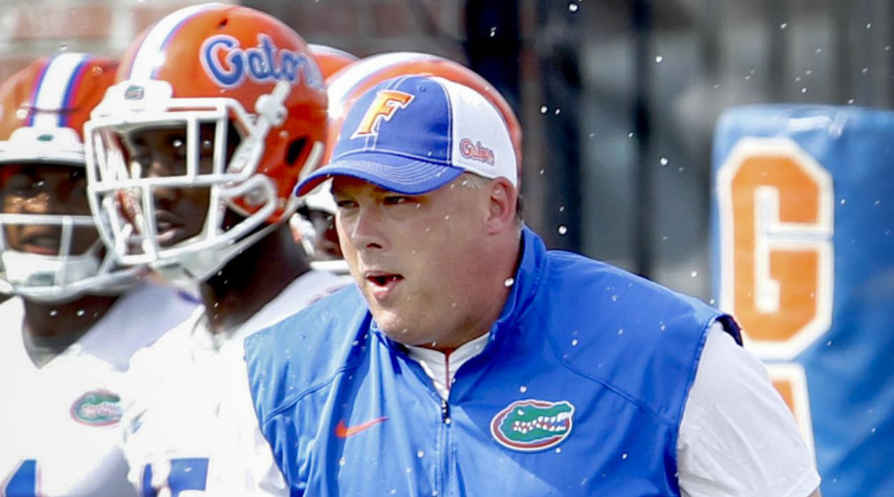FILE - In this March 18, 2015, file photo, Florida defensive coordinator Geoff Collins works with players during NCAA college spring football practice in Gainesville, Fla. A person involved in the negotiations tells The Associated Press that Florida defen