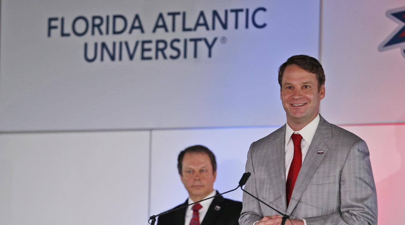 Lane Kiffin speaks after being introduced as the new Florida Atlantic NCAA college head football coach, Tuesday, Dec. 13, 2016, in Boca Raton, Fla. At rear is Florida Atlantic president John Kelly. Kiffin will return to Alabama to continue running the No.