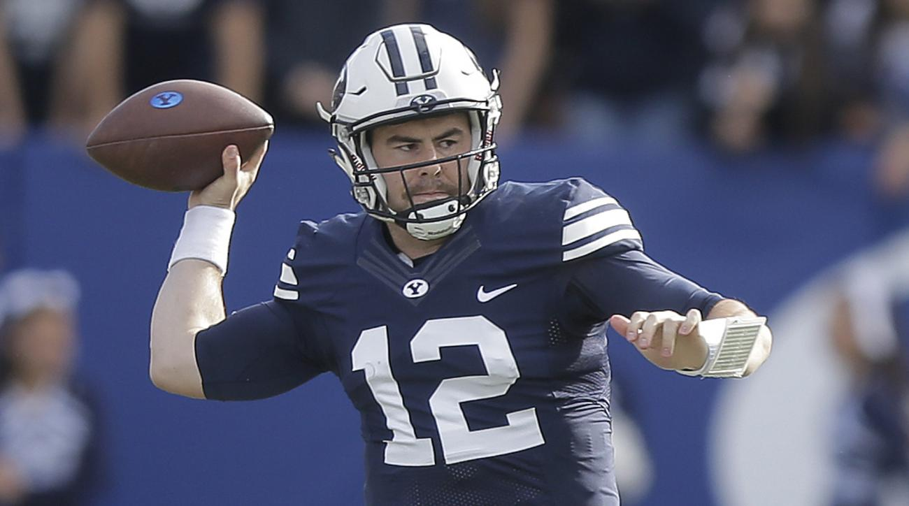 FILE - This Nov. 12, 2016, file photo, shows BYU quarterback Tanner Mangum (12) passing in the first half during an NCAA college football game against Southern Utah, in Provo, Utah. The wait is over for Tanner Mangum. The BYU quarterback sat most of 2016