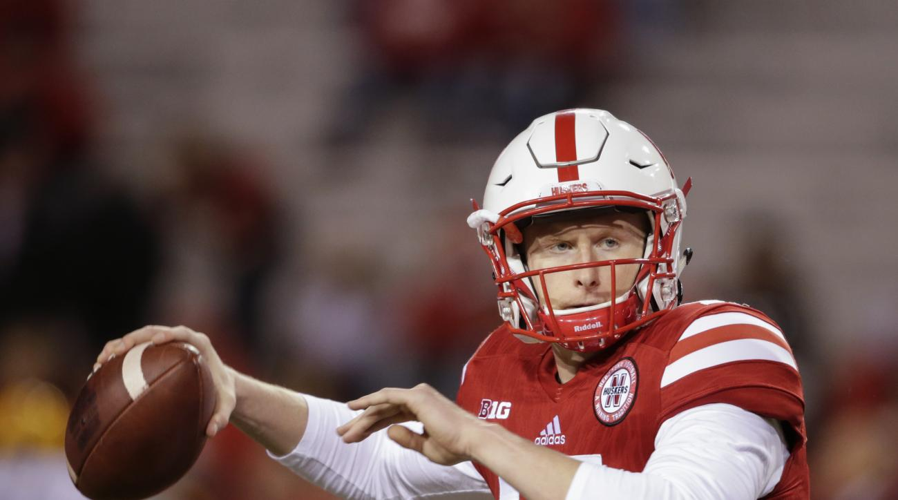 FILE- In this Nov. 12, 2016, file photo, Nebraska quarterback Ryker Fyfe warms up before an NCAA college football game against Minnesota in Lincoln, Neb. While wearing a cast on his left wrist and not able to take snaps from under center, Fyfe is the heal
