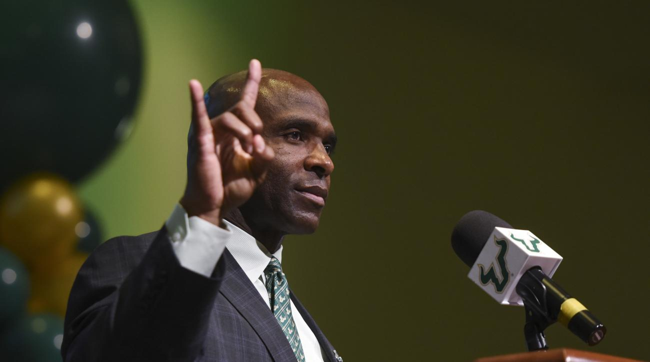 South Florida's new NCAA college football head coach Charlie Strong gestures during a press conference at the University of South Florida in Tampa, Fla., Thursday, Dec. 15, 2016. (Andres Leiva/The Tampa Bay Times via AP) /Tampa Bay Times via AP)