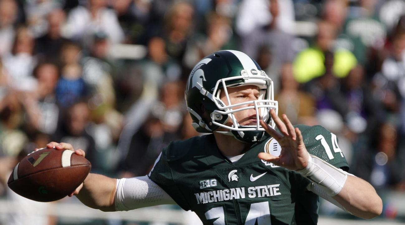 File - In this April 23, 2016, file photo, Michigan State green quarterback Brian Lewerke throws a pass during the second half of the team's spring NCAA college football game, Saturday, April 23, 2016, in East Lansing, Mich. Michigan State coach Mark Dant