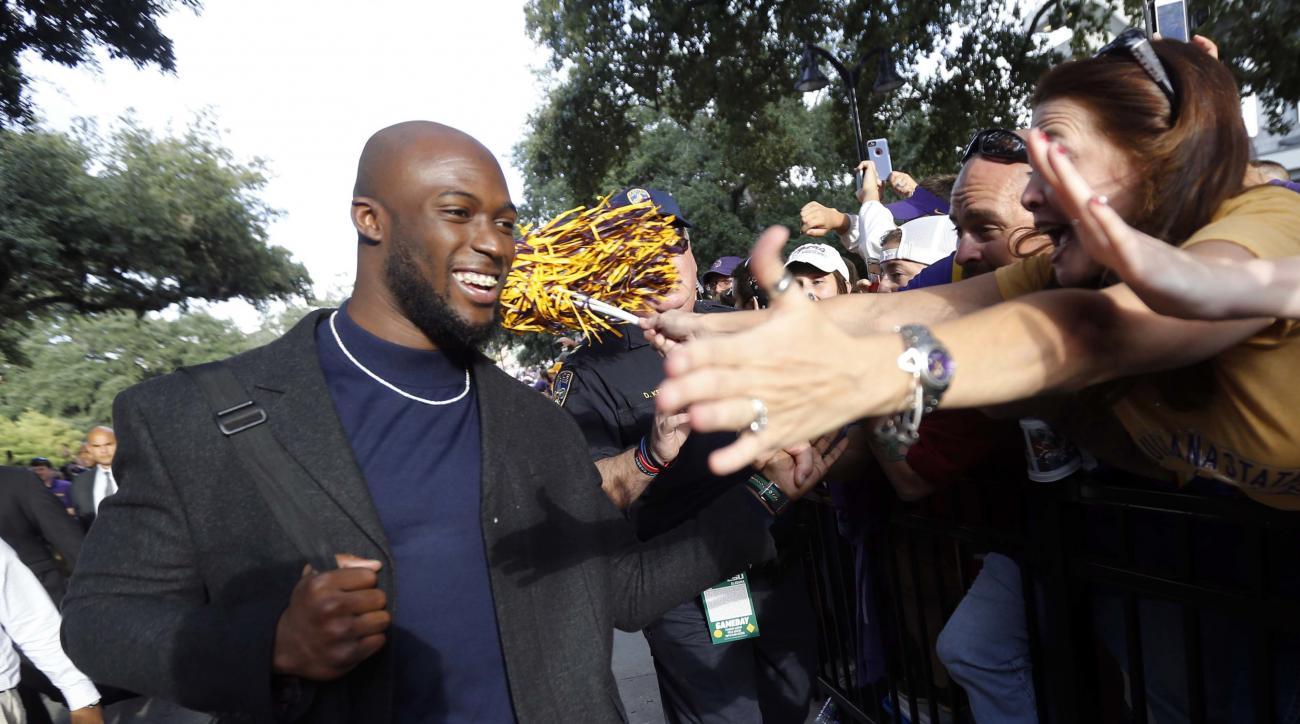 FILE - In this Nov. 5, 2016, file photo, LSU running back Leonard Fournette greets fans as he arrives at Tiger Stadium before an NCAA college football game against Alabama, in Baton Rouge, La. Fournette will sit out the 19th-ranked Tigers match-up with No