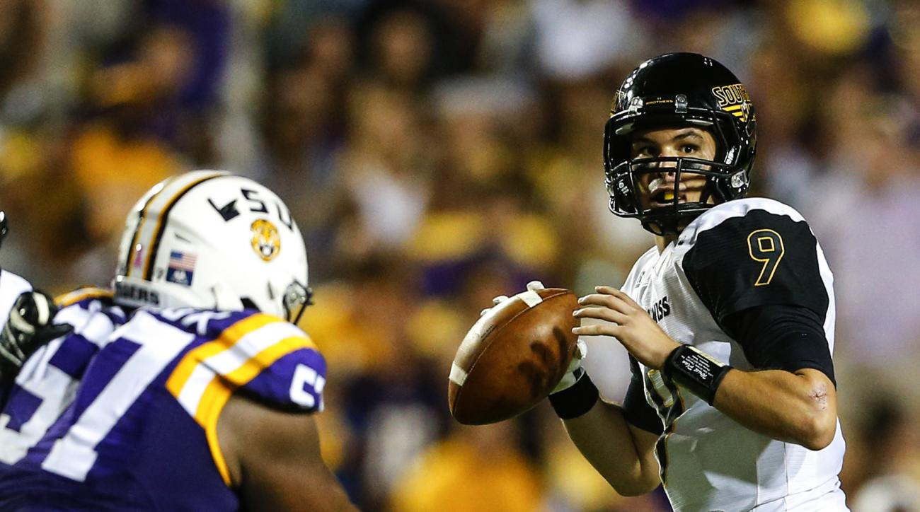 FILE - In a Saturday, Oct. 15, 2016 file photo, Southern Mississippi quarterback Nick Mullens (9) drops back to pass against LSU during the first half of an NCAA college football game in Baton Rouge, La. Southern Miss QB Nick Mullens is the Golden Eagles