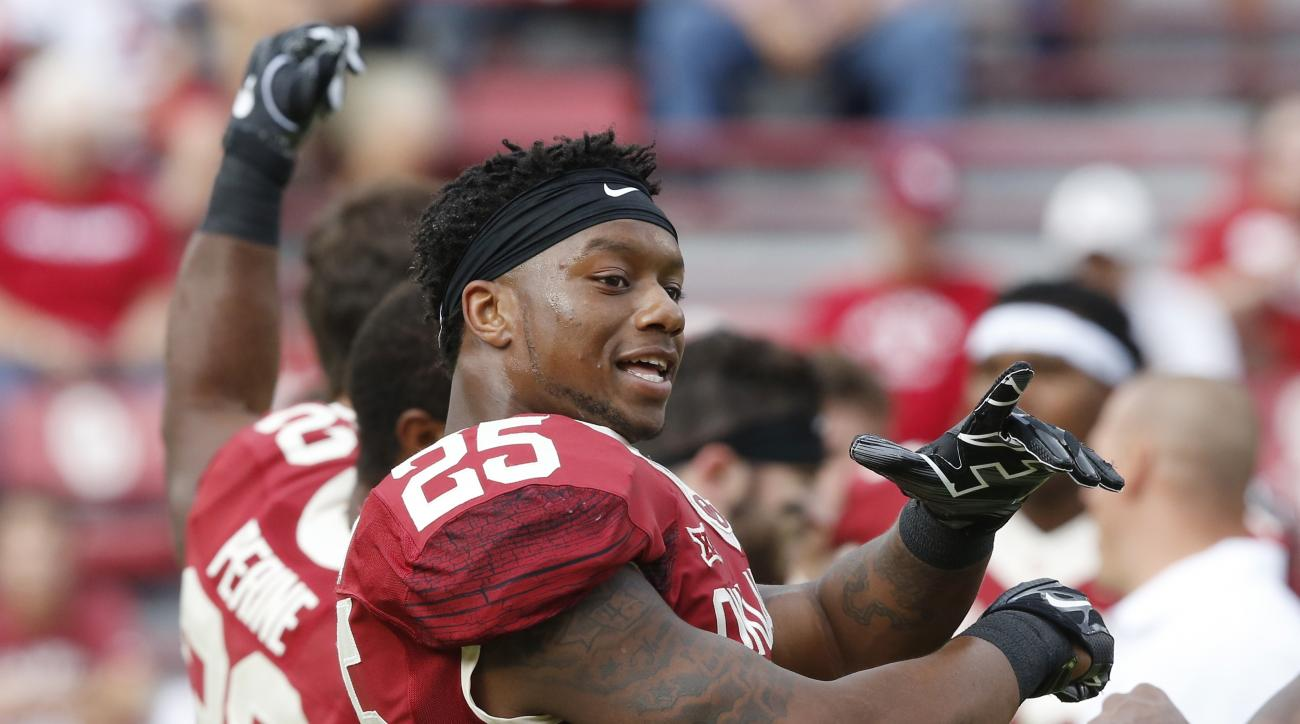 FILE - In this Oct. 15, 2016 file photo, Oklahoma running back Joe Mixon (25) stretches before an NCAA college football game between Kansas State and Oklahoma in Norman, Okla. A video showing Oklahoma running back Mixon punching a female student was relea