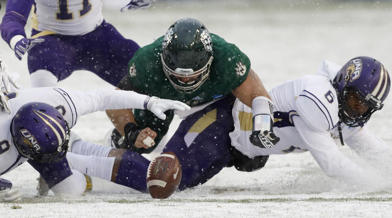 North Alabama cornerback Jaylan Jackson (9) and safety Dorsey Norris (6) and Northwest Missouri State offensive lineman Chase Sherman (62) go after a fumble during the first half of an NCAA Division II National Championship football game, Saturday, Dec. 1