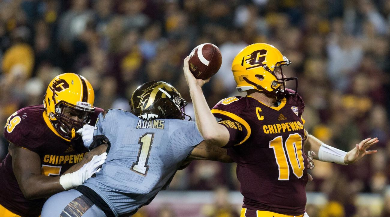 FILE - In this Saturday, Oct. 1, 2016, file photo, Central Michigan quarterback Cooper Rush (10) attempts to throw as Western Michigan defensive end Keion Adams (1) gets a hand on him during the first half of an NCAA college football game in Mount Pleasan