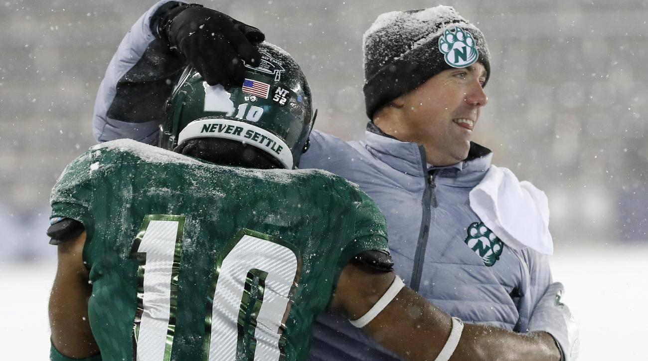Northwest Missouri State's Emanuel Jones (10) celebrates with head coach Adam Dorrel in the finals seconds of the NCAA Division II championship college football game, Saturday, Dec. 17, 2016, in Kansas City, Kan. Northwest beat North Alabama 29-3. (AP Pho