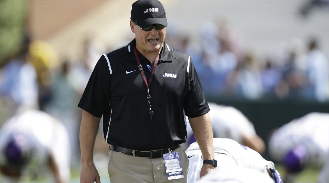 James Madison head coach Mike Houston watches prior to an NCAA college football game against North Carolina in Chapel Hill, N.C., Saturday, Sept. 17, 2016. (AP Photo/Gerry Broome)