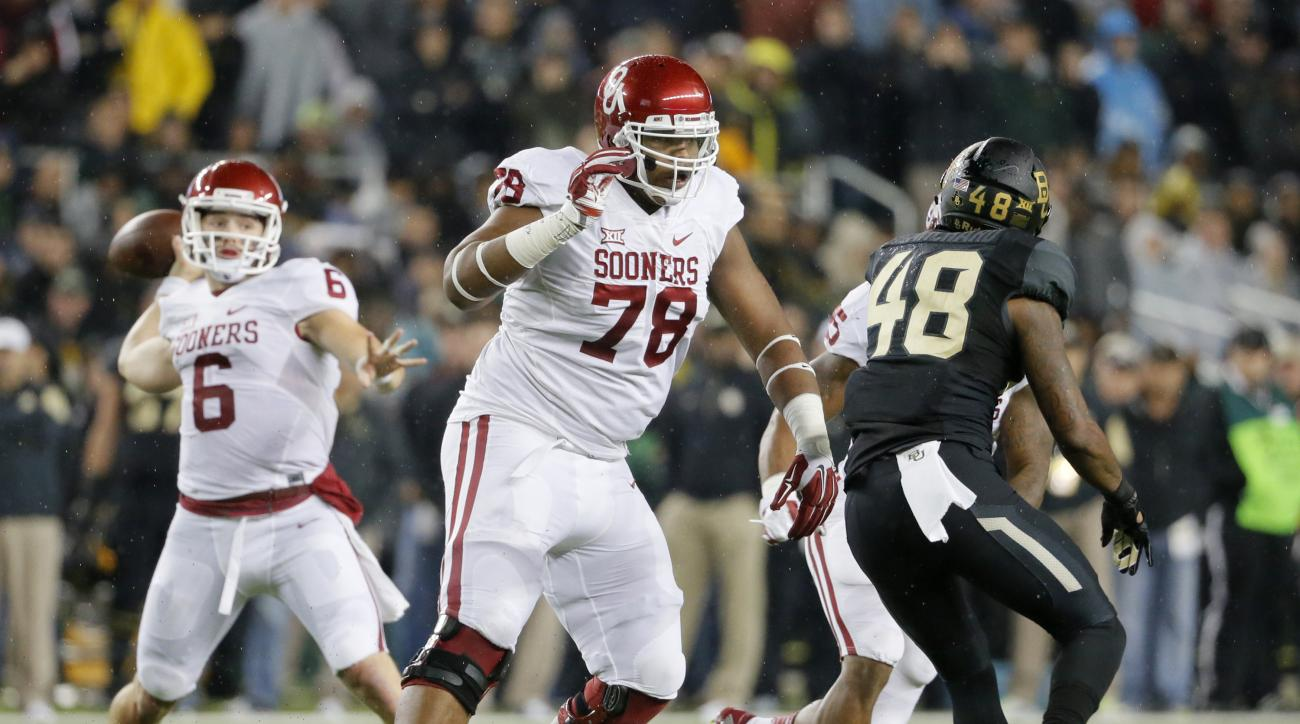 "FILE - In this Nov. 14, 2015, file photo, Oklahoma offensive tackle Orlando Brown (78) keeps Baylor's Travon Blanchard (48) away from quarterback Baker Mayfield during an NCAA college football game in Waco, Texas. Orlando ""Zeus"" Brown Jr. is a second team"