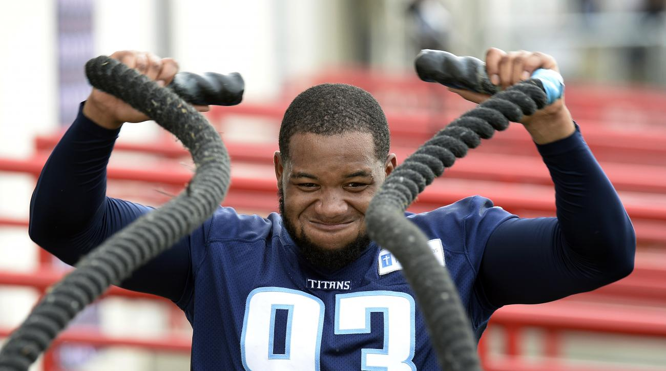 FILE - In this Aug. 4, 2016, file photo, Tennessee Titans outside linebacker Kevin Dodd does a conditioning drill with heavy ropes during NFL football training camp in Nashville, Tenn. Each college football team that reaches the postseason gets additional