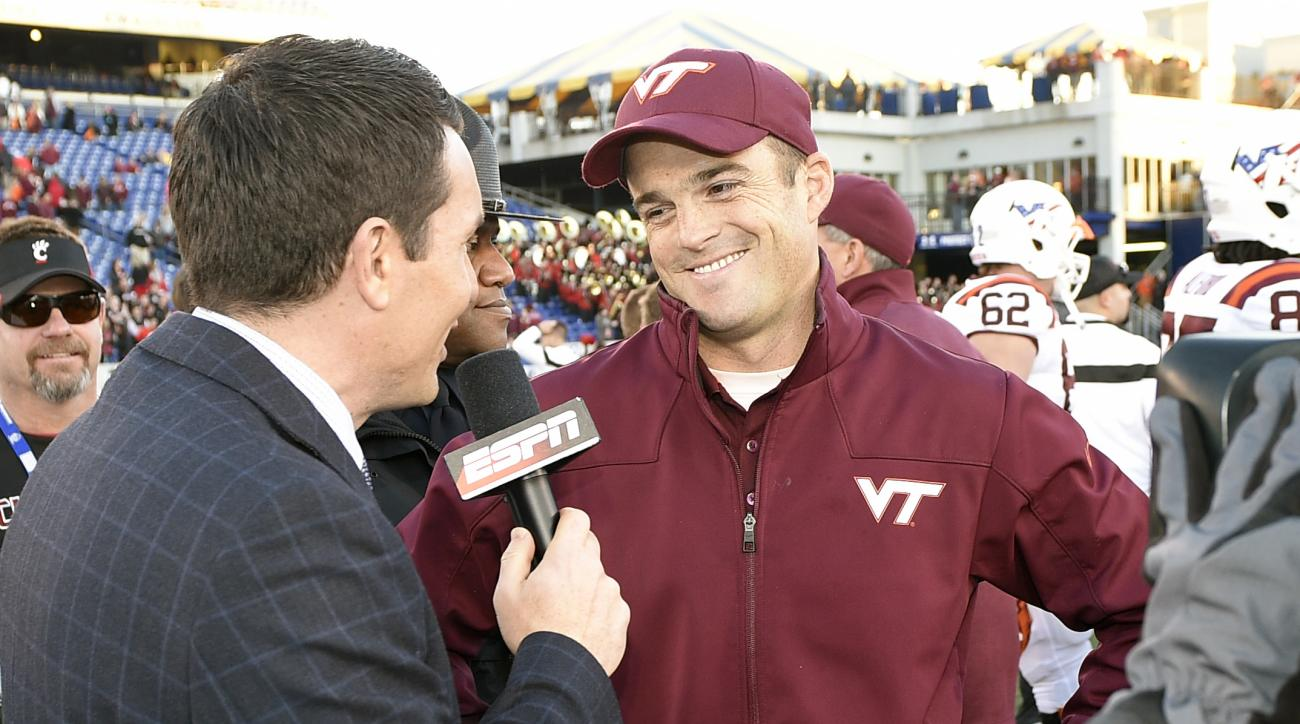 FILe - In this Dec. 27, 2014, file photo, Virginia Tech associate head coach Shane Beamer smiles as he is interviewed by ESPN after the Military Bowl NCAA college football game against Cincinnati, in Annapolis, Md. Shane Beamer, the associate head coach a