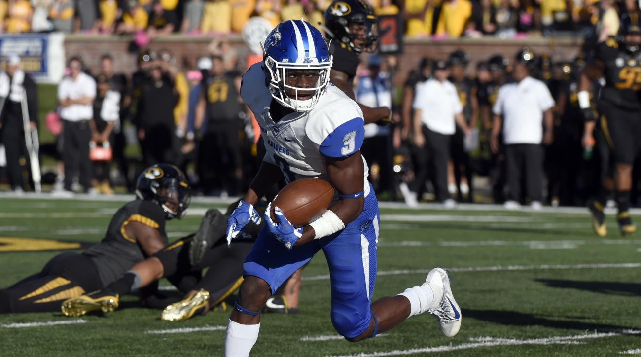 FILE - In this Oct. 22, 2016, file photo, Middle Tennessee wide receiver Richie James scores a touchdown after catching a pass during the first half of an NCAA college against Missouri, in Columbia, Mo. Middle tennessee will play Hawaii in the Hawaii Bowl