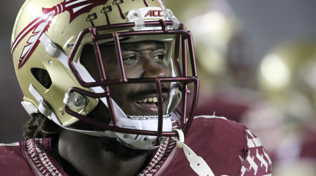 FILE  In this Nov. 11, 2016 file photo, Florida State's Dalvin Cook smiles as he prepares to play Boston College in an NCAA college football game in Tallahassee, Fla. Cook has had his share of great games at Hard Rock Stadium. The Miami native could be pl