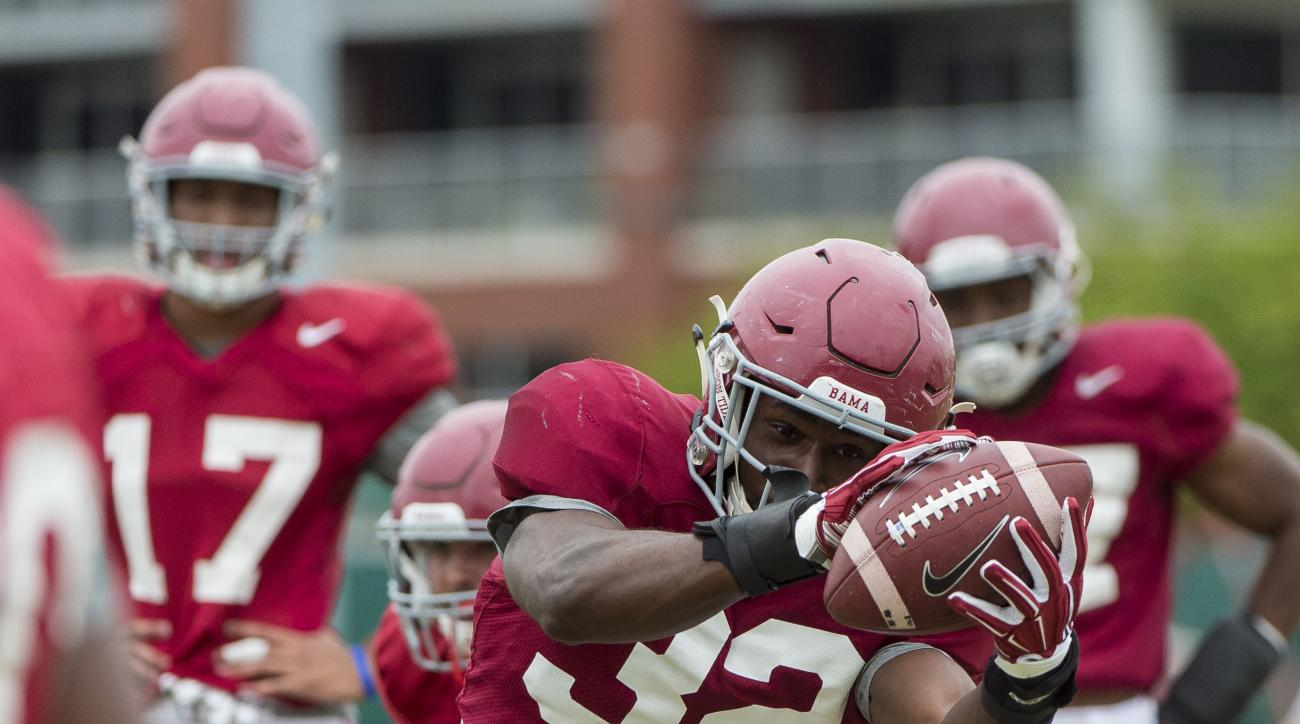 FILE - In this April 12, 2016 file photo, Alabama linebacker Rashaan Evans (32) works through drills during spring football practice at the Thomas-Drew Practice Fields in Tuscaloosa, Ala. Evans has had some of his biggest moments in Alabama's most importa