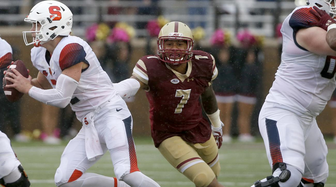 FILE - In this Oct. 22, 2016, file photo, Boston College defensive end Harold Landry (7) reaches out for Syracuse quarterback Eric Dungey (2) during the first half of an NCAA college football game, in Boston. Maryland and Boston College are meeting in Det